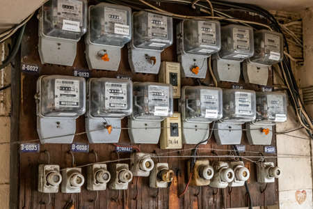 Bangkok, Thailand - Jun 19, 2020 : Watthour meter of electricity for use in home appliance.This is a modern technology that can monitor the old apartment room,  Electrical energy consumption.Electric control transformer. Electricity meter.