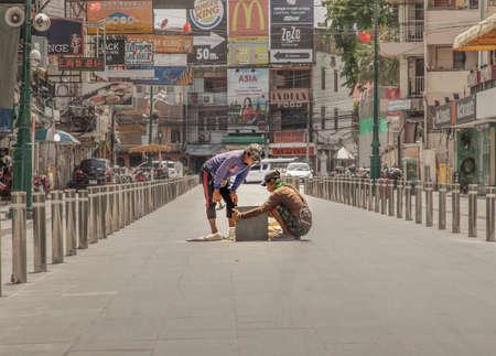 Bangkok, Thailand - Jun 19, 2020 : Two Labors are working on street reconstruction on Khaosan road.