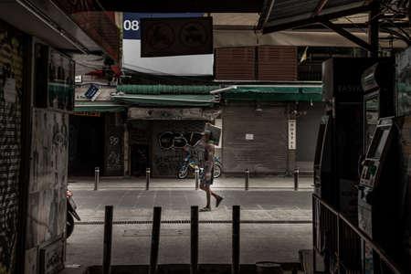 Bangkok, Thailand - Jun 19, 2020 : Labor is carrying tiles for street reconstruction Khaosan road.