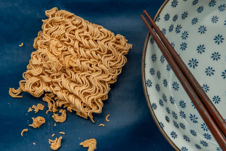 Easy food, Dried instant noodles and hot water in a bowl.