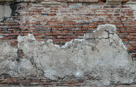 Close-up of Cracked concrete vintage brick wall background. Archaeological area. Pattern on the wall with space for text, No focus, specifically.