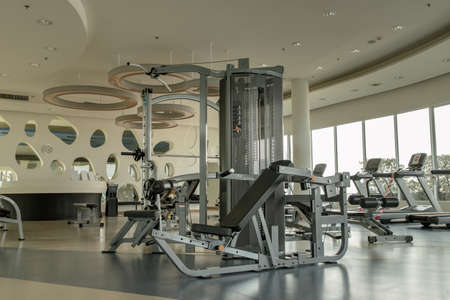 Bangkok, Thailand - Jan 28, 2021 : New normal concept and physical distancing within gym or fitness studio with modern fitness equipment for fitness events and more. Modern of gym interior with equipment. Sports equipment in the gym. Selective focus.
