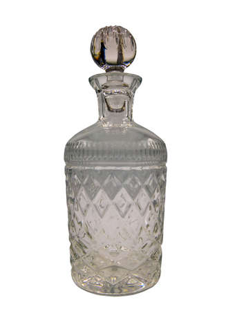 Empty crystal decanter with engraving, Closed with a glass stopper isolated on white background with clipping path. Selective focus. Zdjęcie Seryjne