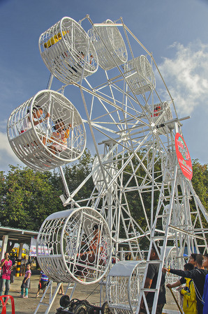 theme park: Many people are playing Ferris Wheel in the small theme park in Thailand Editorial