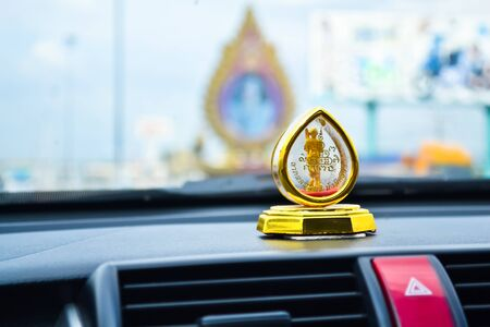 Buddha in car photo