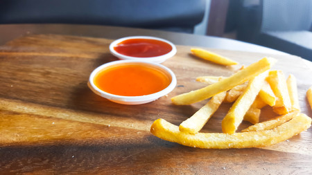 French fries with ketchup on wooden