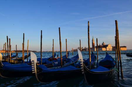 Row of Gondola boats on Grand Canal, Venice, Italy