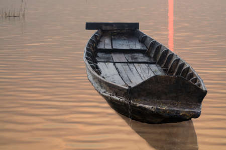 wooden boat: Wooden boat in reservior. Stock Photo