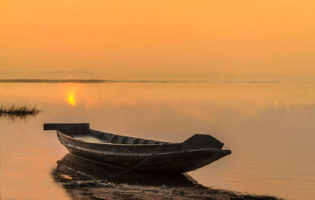 fishingboat: Wooden boat in reservior at morning.