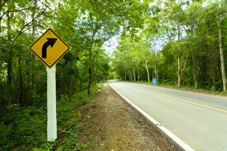complicated journey: Traffic sign tell the curve on the road