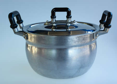 utensilios de cocina: Used metal stock pot isolated on white. Cookware