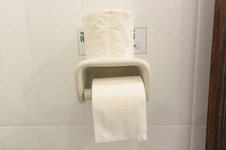 contradiction: Good day, bad day concept of full bathroom tissue roll