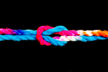 Connected group concept as many different ropes tied and linked together as an unbreakable chain as a community trust and faith metaphor and learning Stock Photo