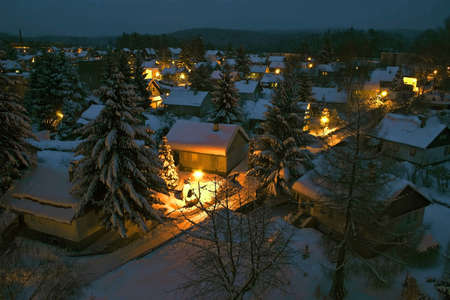 View to a night village covered with snow