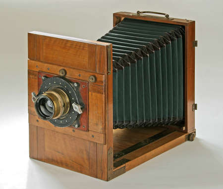 folding camera: vintage wooden folding camera isolated