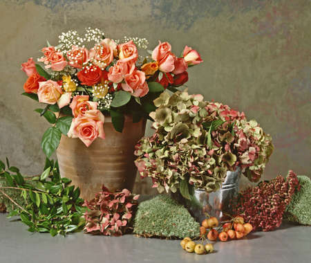 still life with a bunch of roses and dry hortensias