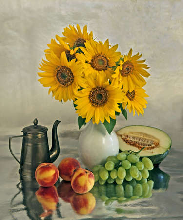 Still life with a sunflowers in vase and different fruits