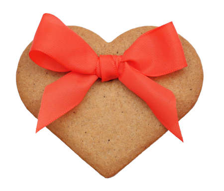 Christmas decoration - ginderbread heart with a red ribbon photo