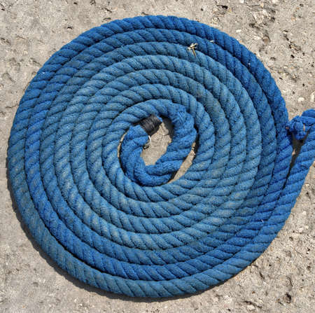 coiled rope: blue rope coiled at pier