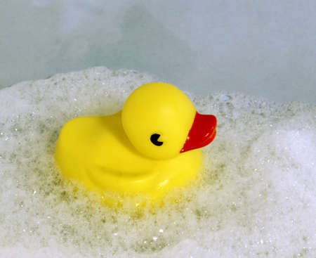 yellow toy duck in soap foam photo