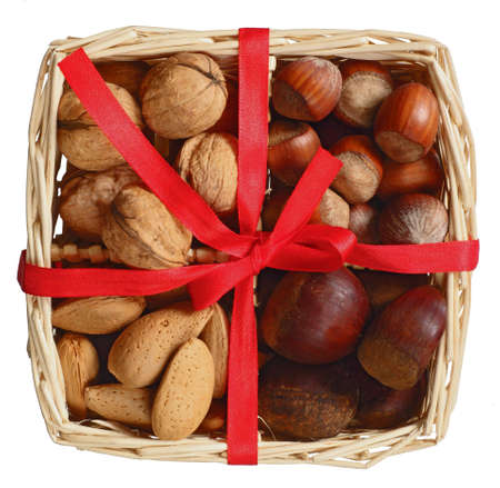 christmas basket with almonds and nuts isolated in white Stock Photo - 8379707