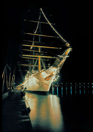 iluminate: display lighted sailing school ship in harbor  Stock Photo