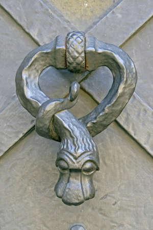 medieval metal knocker at church door photo