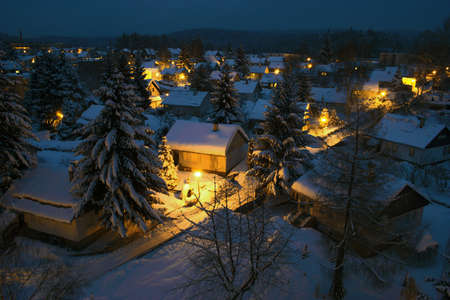 lightness: View to a night village town covered with snow Stock Photo
