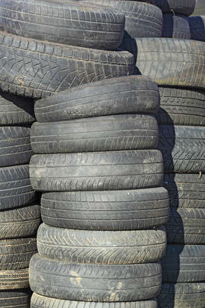 heap of dirty, old, used car tires