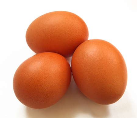 three eggs isolated in white Standard-Bild