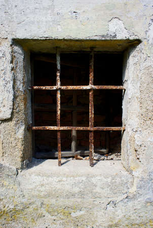 old grunge small window barred by rusty bar                    Standard-Bild