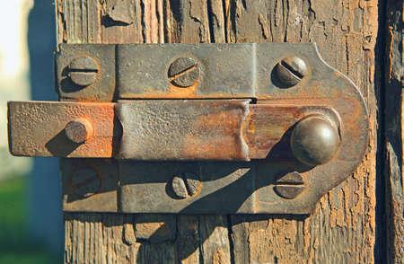 wicket: old rusty latch on a wooden wicket