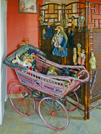 still life with buggy and marionettes Standard-Bild