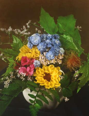 bunch of field flowers in a vase