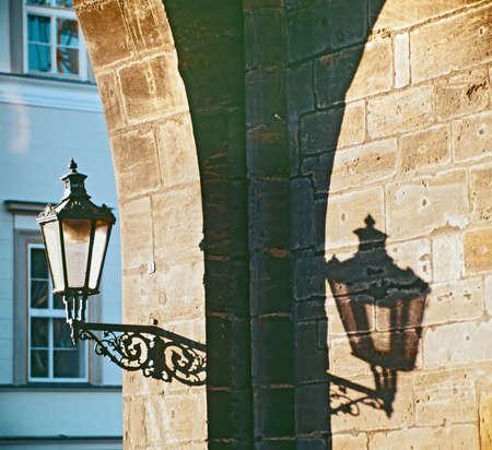 Prague, Charles bridge - gas lamp on the Old town bridge tower - Czech republic