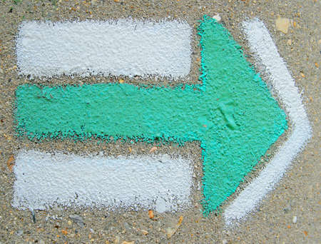 green arrow mark at the wall