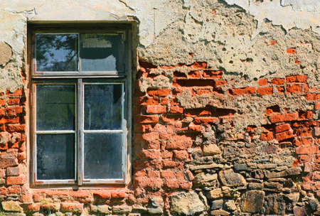very grunge brick wall with the window