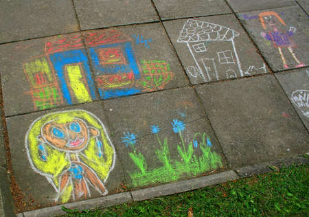 children chalk drawing at a pavement