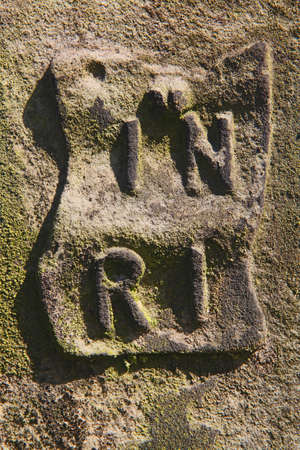 stone tombstone: INRI letters at an old tombstone