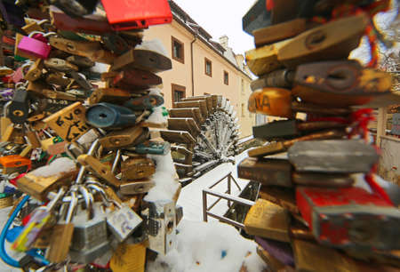 Prague mill wheelwith a padlocks covered with the snow - Czech republic