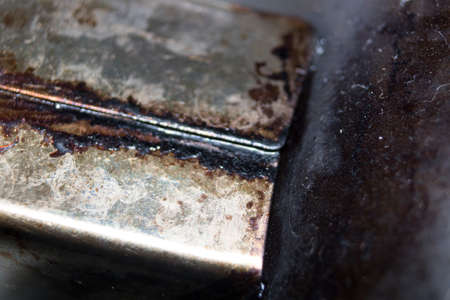 smeary: oily rusty dirty metal macro detail photo Stock Photo