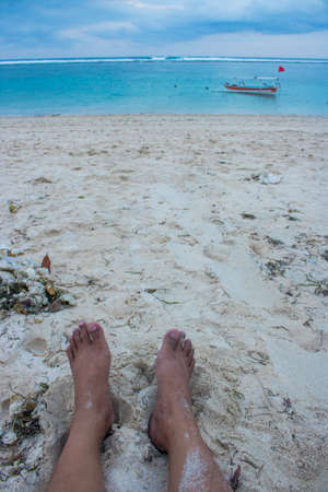 Feet on beach sand view summer holiday photo Stock Photo
