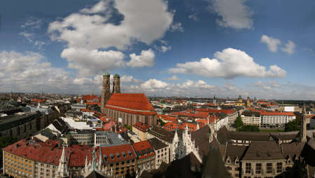 Skyline of Munich, capital of Bavaria in southern Germany and home of the famous Oktoberfest. 140° panoramic view from the town hall tower with the church Frauenkirche in the center. XXL picture with 5500x3105 pixels!