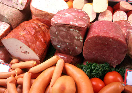 Different german gastronomic meat and sausage specialties in a german butchers shop photo