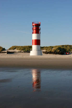 The lighthouse of the small Helgoland neighbor island Duene in the german north sea photo