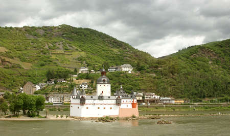 coastal feature: The romantic castle Pfalzgrafenstein near Kaub, island in the river Rhine (Rheinland-Pfalz, Germany) with vineyards in the background