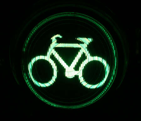 Green traffic light for bikers at night photo