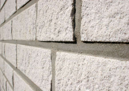 The white and clean brick wall of a new built house