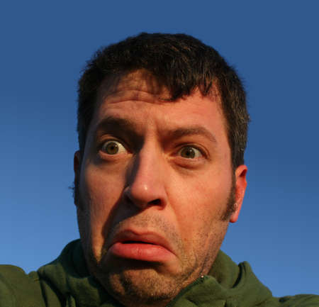 expressing: Man with a damn stupid and surprised look Stock Photo