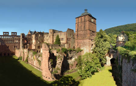 The Heidelberg Castle, famous ruin and landmark of the beautiful medival city Heidelberg, Germany. In the middle Ruprechtsbau, the towers Torturm and Gefängnisturm and the deep moat Hirschgraben.